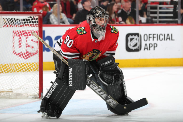 Scott Foster, CPA, Senior Financial Accountant, at Golub Capital, playing as goalie for the Chicago Blackhawks in his first ever NHL game.